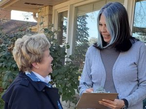 Cherryl Strathmann talking with a voter