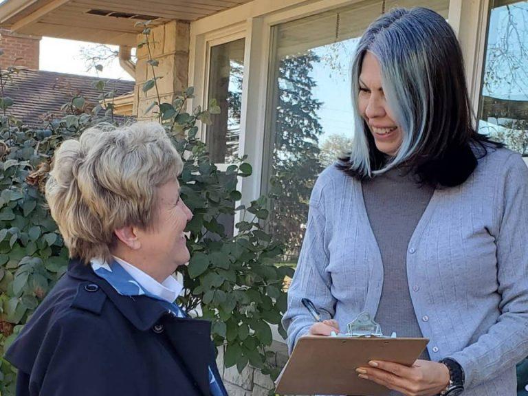 Cherryl Strathmann talking with a voter